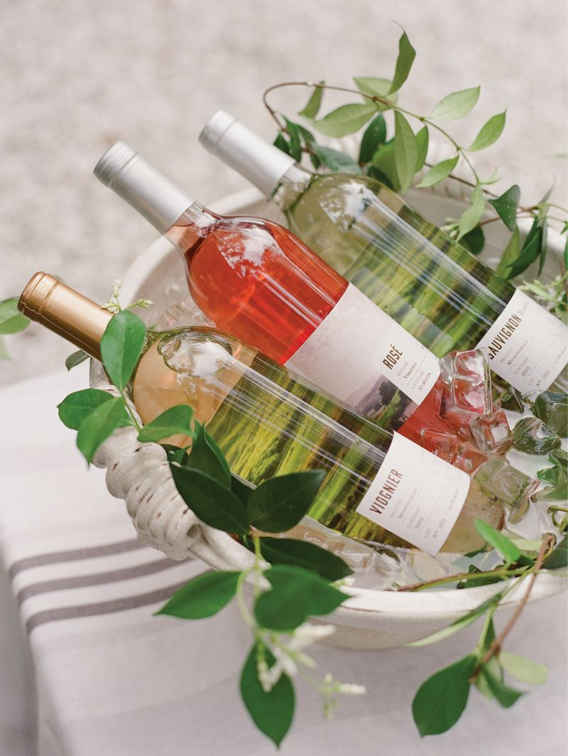 """For the """"bar,"""" Lynn filled a Vietri planter with ice and just-plucked jasmine vines to chill a variety of their Pippin Hill Farm & Vineyard wines."""