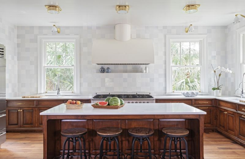 Brass ceiling lights and wall sconces from Urban Electric in the kitchen continue the nautical motif, while the Delft tile in an off-white mix adds depth and dimension.