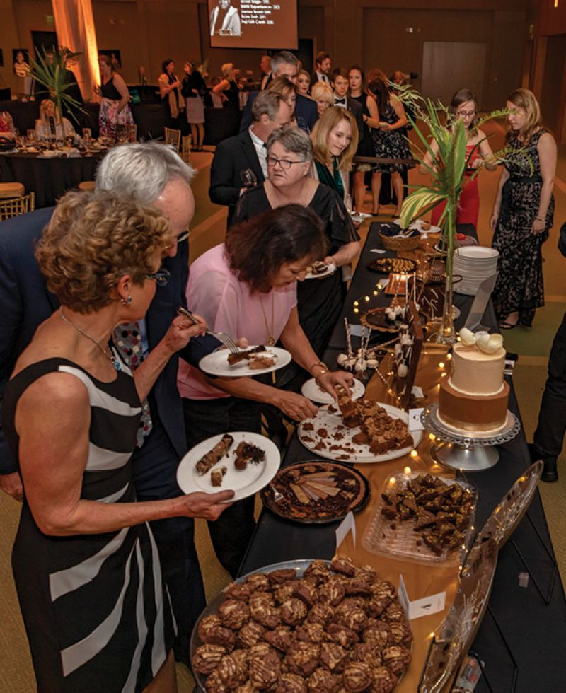Attendees lined up to try treats from more than 15 local bakeries and restaurants.