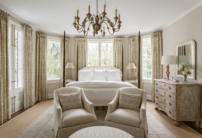 TONY TONES: Taupe, camel, and cream are enlivened with understated patterns and hints of the tropical foliage just beyond the windows in this soothing master bedroom, with a custom poster bed by North Charleston's Nietert Antique Restorations.