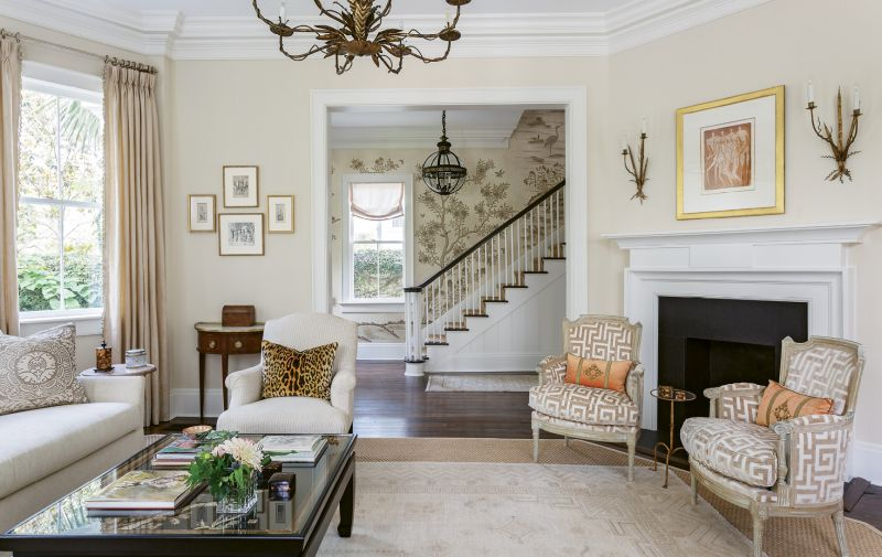 The homeowners scoured local galleries for art, selecting the Otto Neumann monotype from Anne Long Fine Art for a modern touch above the mantel and the Alfred Hutty and Elizabeth O'Neill Verner etchings on the far wall as a nod to local history.