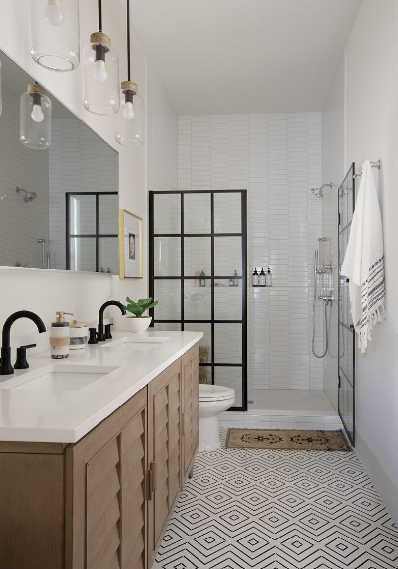 GRAPHIC DETAIL: Geometric Riad floor tiles pick up on splashes of black in the paned shower door and Delta Trinsic fixtures in this streamlined master bath