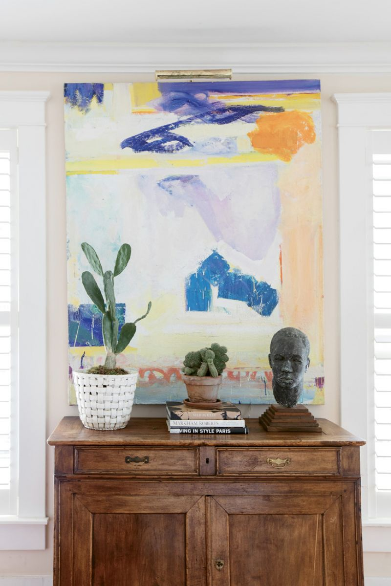 Art Works: An abstract painting by California-born artist Frank O'Cain is a wash of color in the family room. Debbie likes to juxtapose contemporary art with the vintage and antique furnishings.