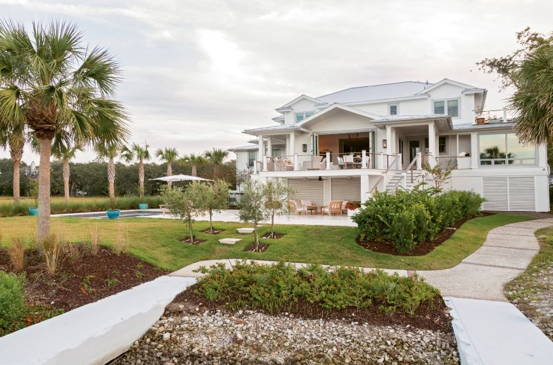 Sitting Pretty: Just steps from Shem Creek, the McElveens found the ideal location, but not the perfect property. So the couple embarked upon a complete renovation, stripping away '90s embellishments, such as ornate columns and a two-story foyer, to create a modern yet timeless architectural style.