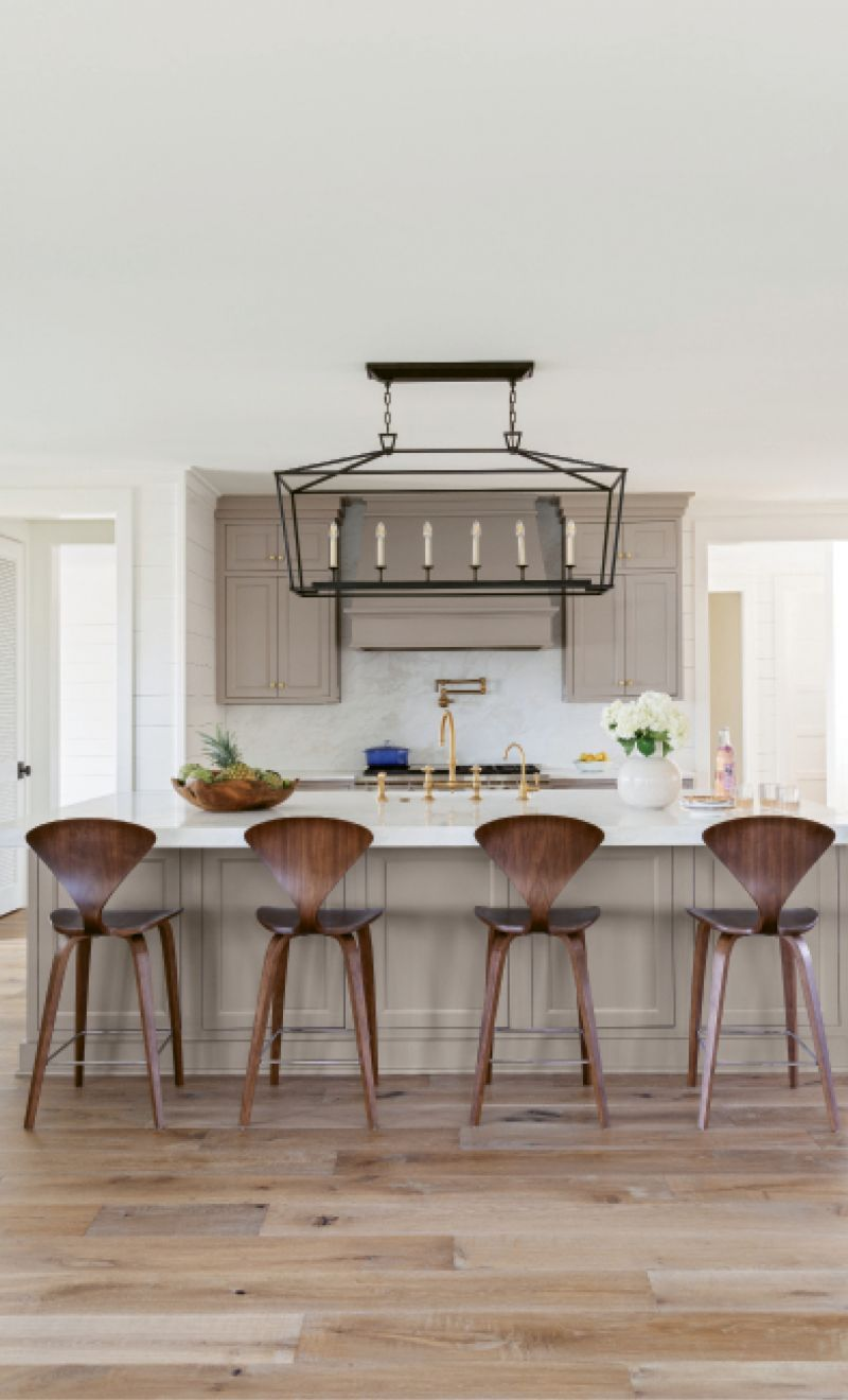 Style & Simplicity: A minimalist kitchen is accented by mid-century modern stools from Design Within Reach, while the usual cooking accoutrements can be found in the butler's pantry, right off the kitchen.