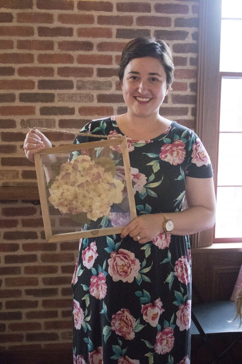 Lauren Whiteside Mann of Southern Bloom Press shows off her masterpiece.