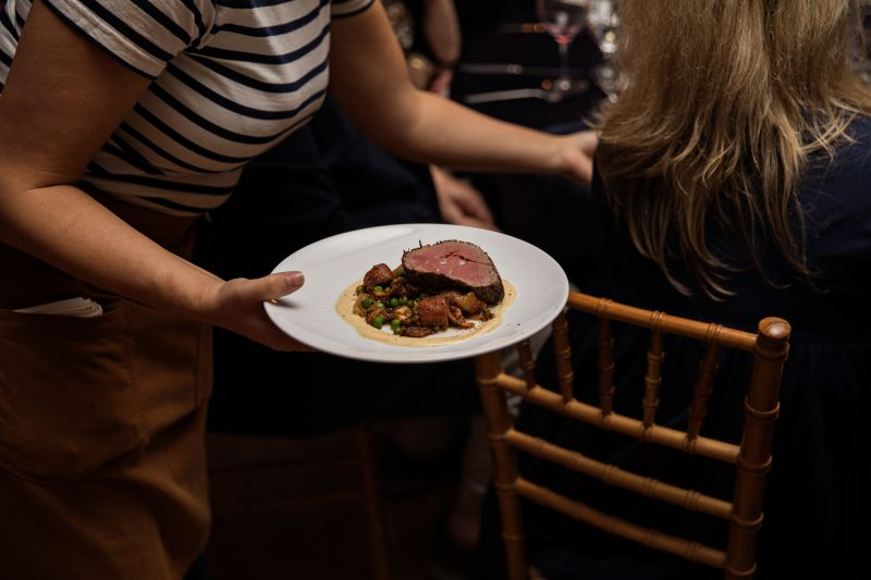 Seared beef tenderloin with sweet potatoes, oyster mushrooms, peas, and brown butter hollandaise by Will Fincher of The Obstinate Daughter and Wild Olive.