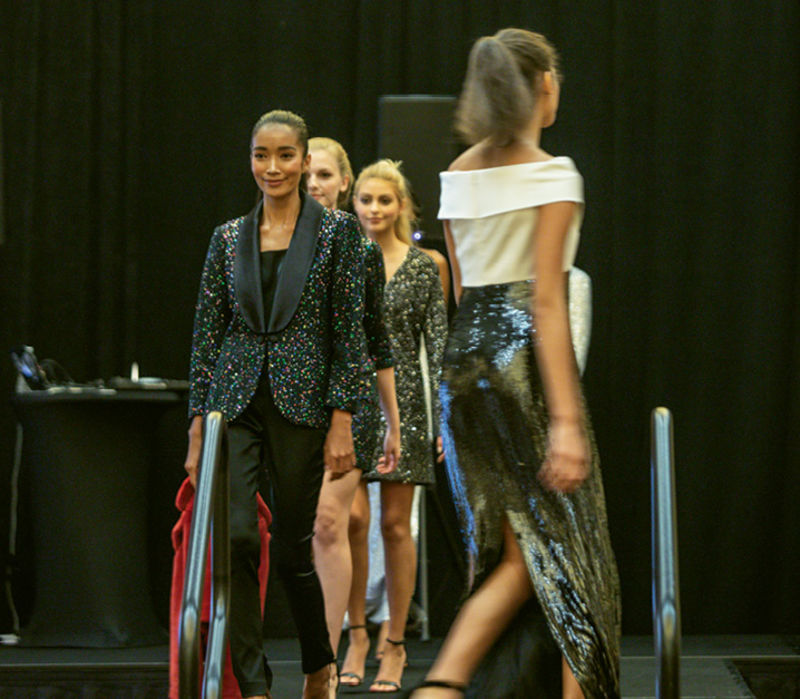 Angelina Anderson, Nara King, Cora Bisbee, and Shelby Ludema walking the runway