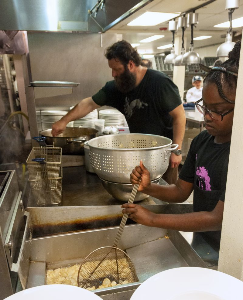 Big Chef Bob Cook of Edmund's Oast and Little Chef Nia Khan fry potato slices.