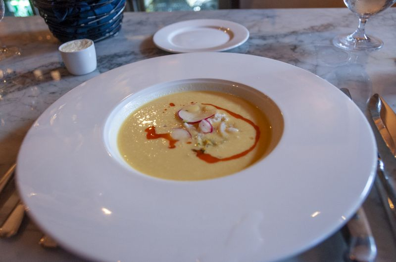 Big Chef Robyn Guisto of Halls Signature Events and Little Chef Abraham Aguilera's chilled corn and coconut bisque with lobster tails and corn shoots.