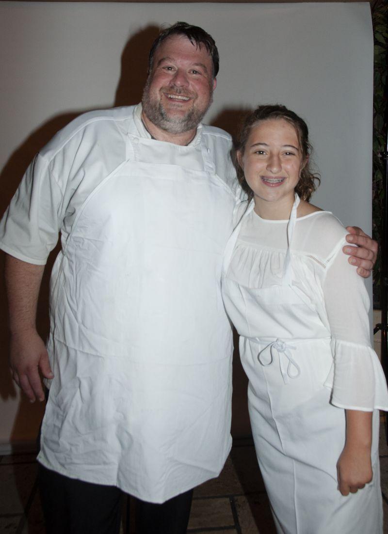 Big Chef Richard Plaistowe of Halls Management Group with Little Chef Isabella Hurd after presenting their raspberry dessert.