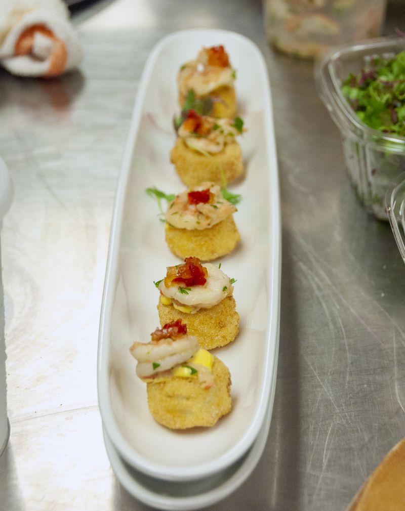 Crispy shrimp grit cake with saffron aioli and pepper jam.