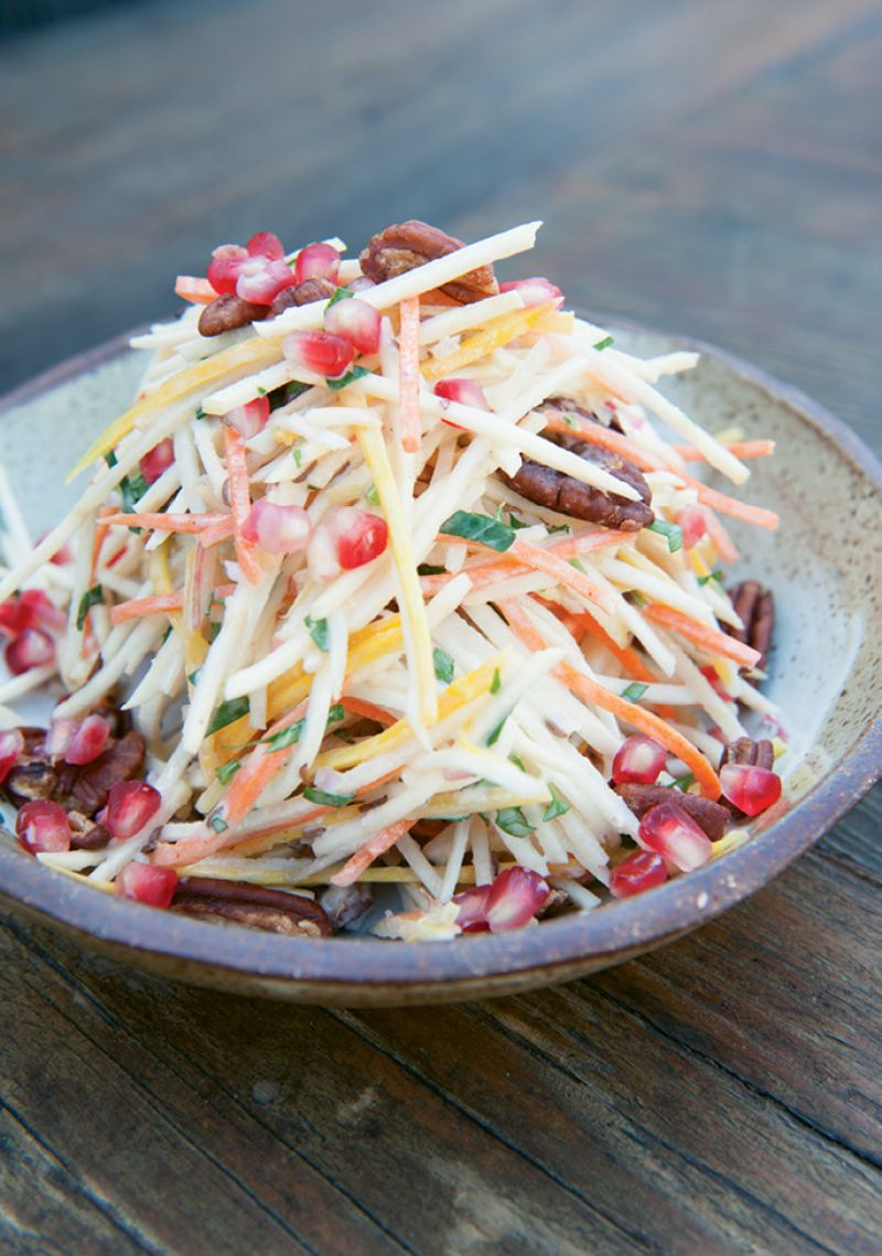 Bright Side: Pomegranate seeds, rainbow carrots, parsley, and pecans add pops of color to the dish.