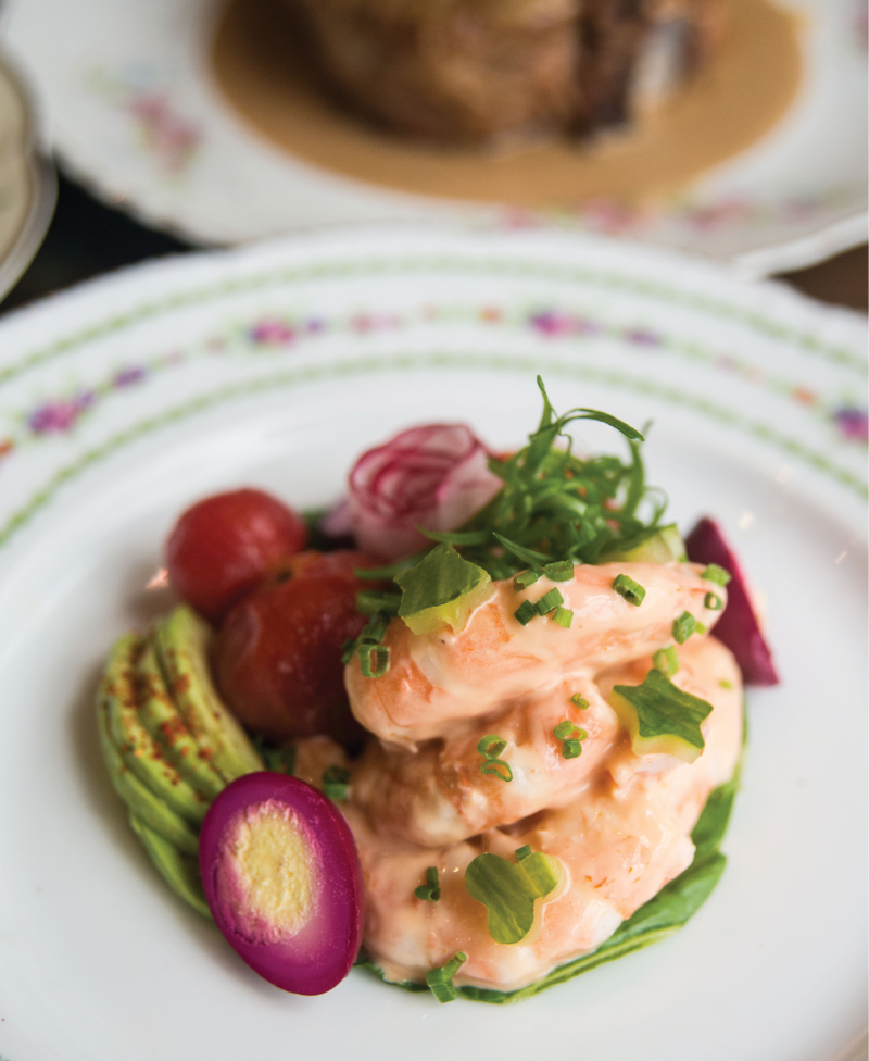 A kaleidoscope of flavors and colors characterizes McCrady's Tavern's dressed shrimp appetizer, which blends the creamy shellfish with beet-pickled quail egg, Espelette-spiked avocado, au natural tomatoes, and cucumber cutouts.