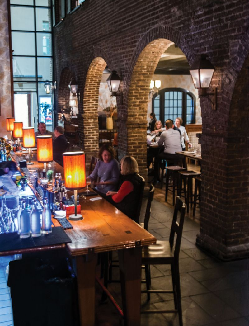 Casual Classic: Brick archways inside the historic building have shed their once-dramatic stained glass alcoves, bringing the former tavern closer to its relaxed roots.