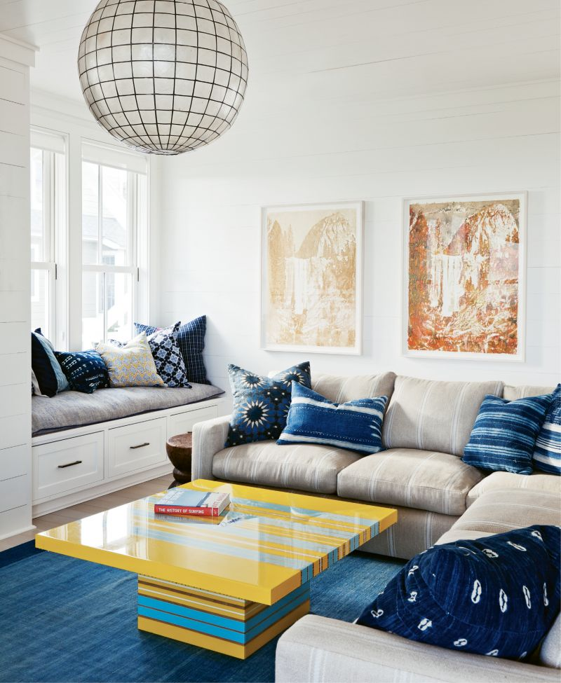 Surf's Up: The family room is a primo spot with a bright yellow and blue surfboard-inspired coffee table. Delicious artwork by Matthew Brandt is made of Gummi Bears and Pixy Stixs.