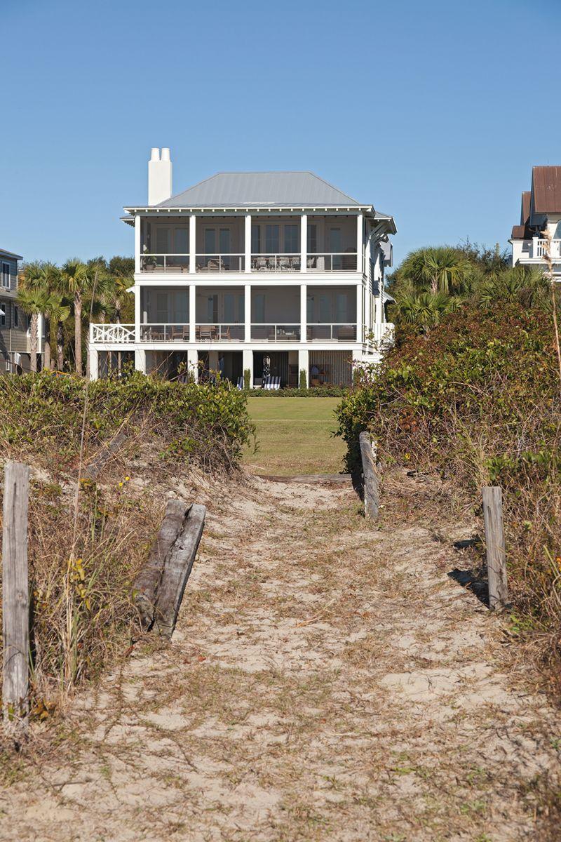 ...while the beachfront façade is a classic, porch-perfect beach house.