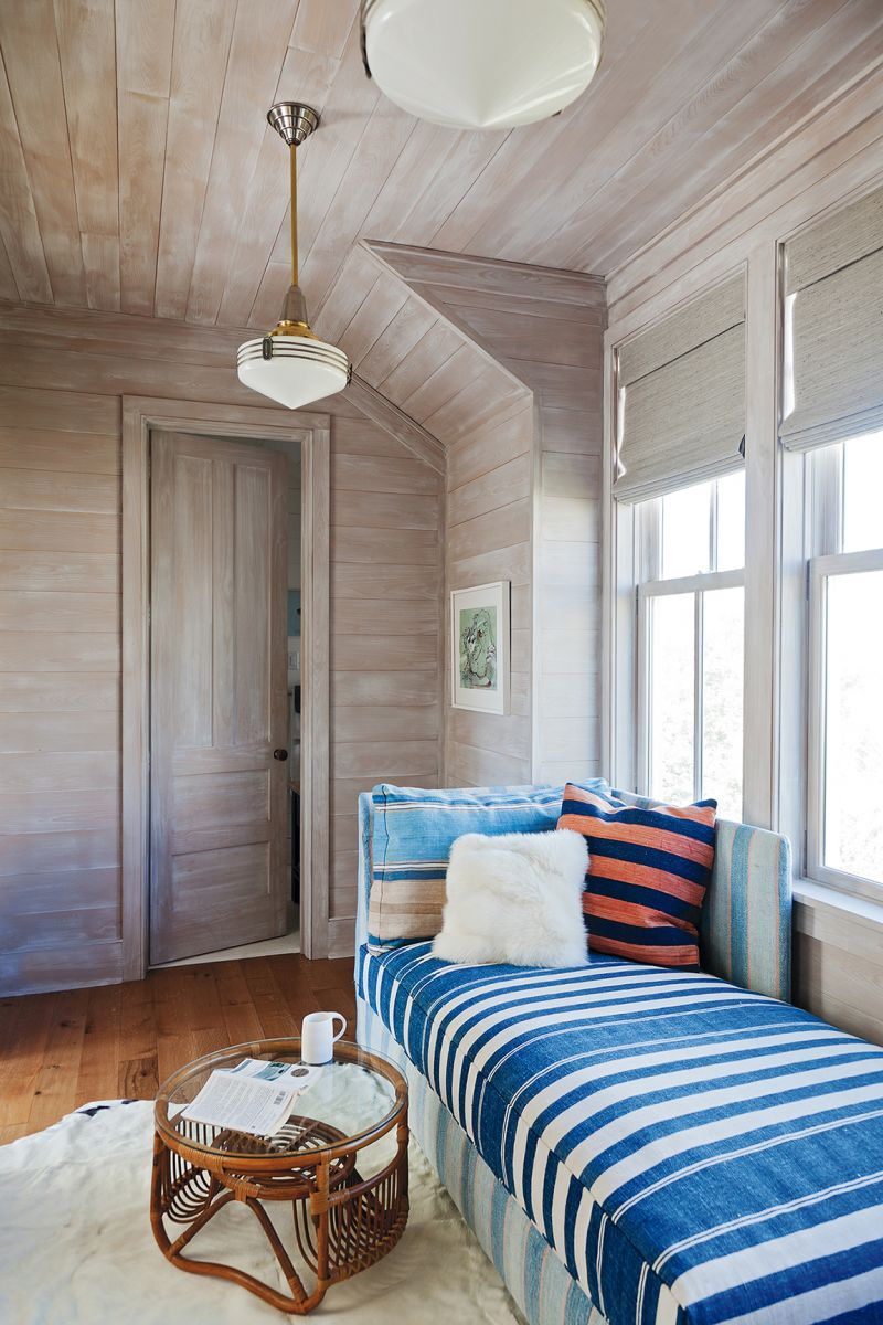 """A double-duty sleeper bench upholstered in a vintage dhurrie in the cedar-lined """"office"""""""