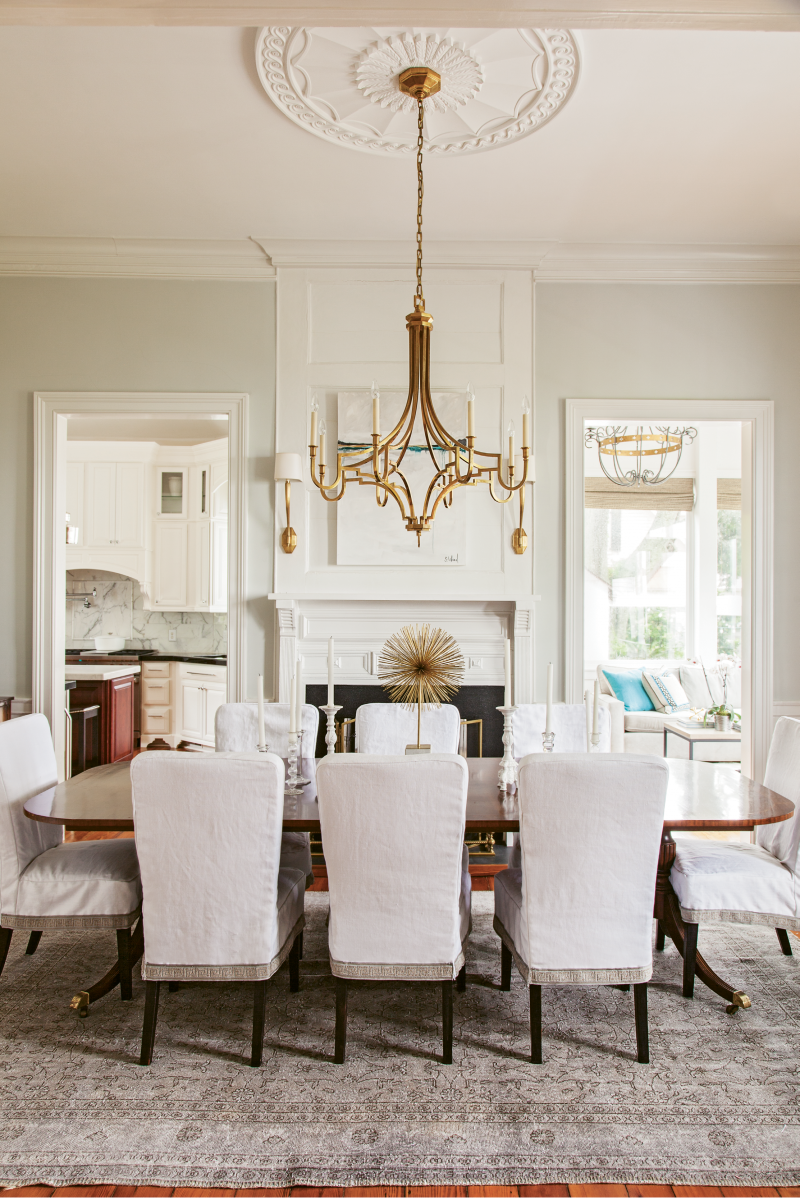 With the help of interior designer Amee Leland, the homeowners replaced numerous heavy and dated crystal chandeliers with sculptural modern selections more suited to the couple's casually sophisticated aesthetic.