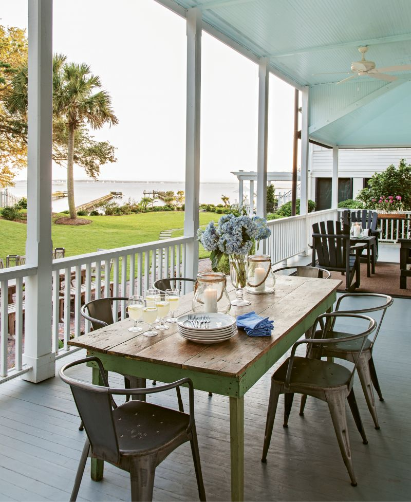 The family spends weekends entertaining friends and relatives with casual outdoor parties that belie the property's formal front façade. A variety of relaxed gathering spaces, including a deep double piazza and brick patio, accommodate guests.