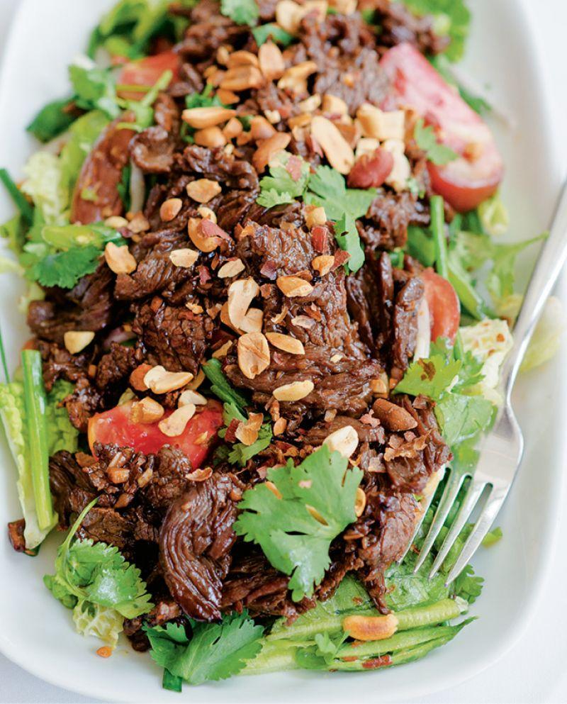 Cook's wok-seared garlic steak with Thai salad