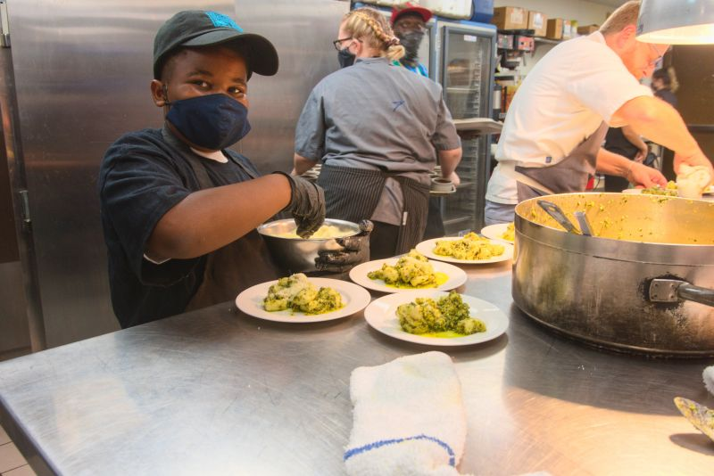 Little chef Grant Higgins, who was partnered with Rodney Scott, helps out.