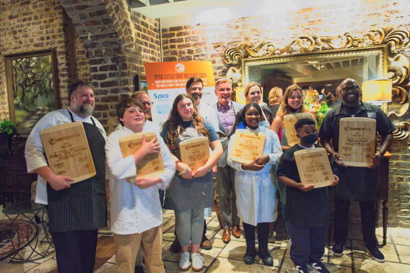 (Left to right) Richard Plaistowe, Trevin Lamber, Jacques Larson, Chloe Farkouh, Mike Lata, Louis Yuhasz, Journee Myers, Carrie Morey, Claudia Hassell, Grant Higgins, and Rodney Scott