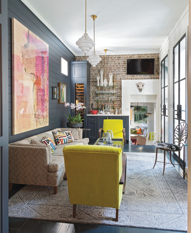 """Trading Spaces: Formerly a slim galley kitchen, this """"hyphen"""" connecting the Ansonborough single house to its guest suite was transformed into a chic lounge space, complete with wet bar."""