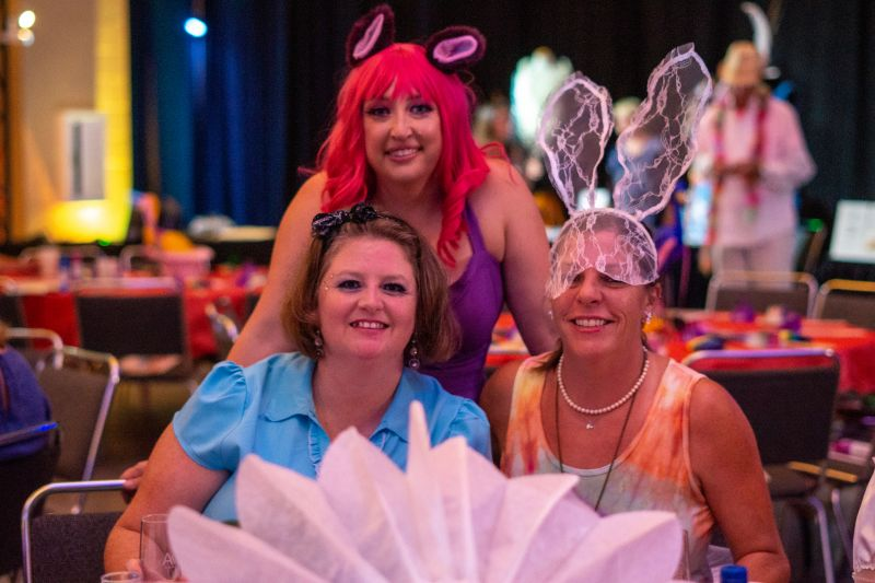 """Amy Morley, Lacy Sherrill, and Susan Ash in their """"Alice in Wonderland"""" costumes."""