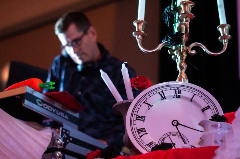 DJ Trevor D amid the Wonderland-themed decor