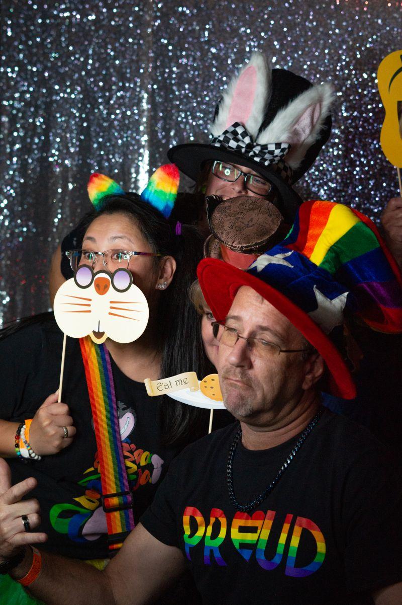 Yumi, Frank, and Lori snap a group shot at the photo booth.