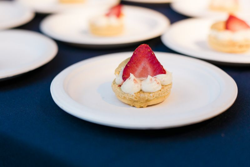 Wildflour Pastry served glittering golden macarons filled with passionfruit, strawberry, and prosecco.