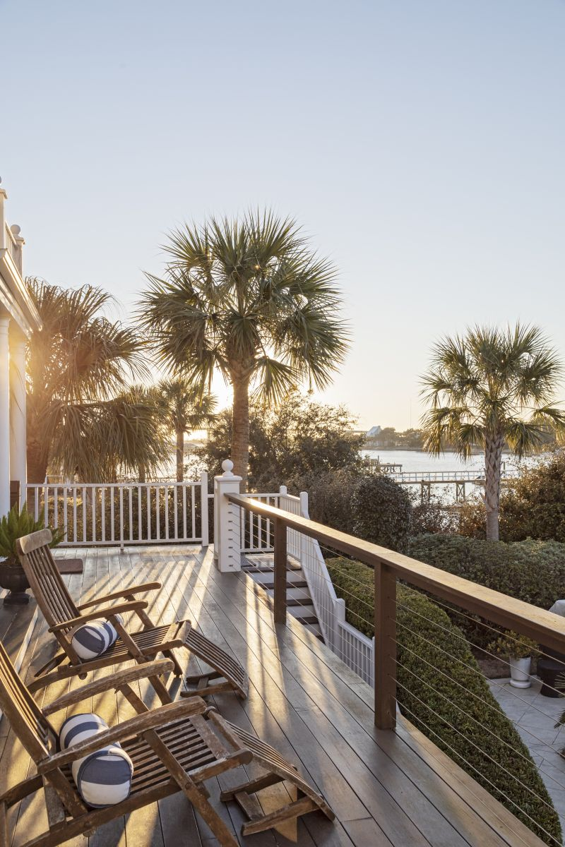 Peggy's favorite are the muted greens and blues of the early evening, when she loves to take in spectacular sunsets from their deck overlooking a swimming pool and deep-water dock.