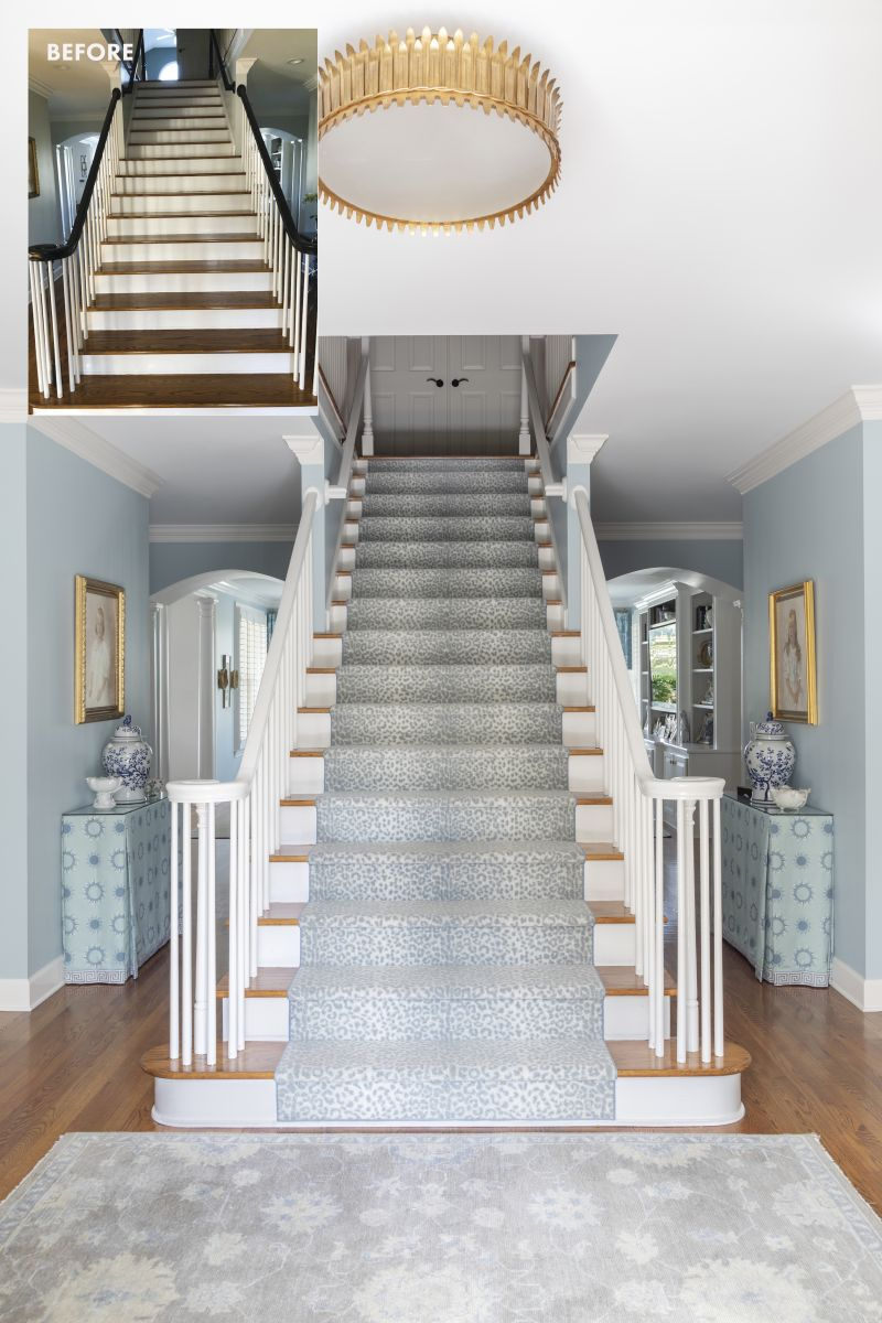 STEPPING IT UP: From traditional to terrific, the entryway and staircase is enlivened by a bold blue leopard-print stair runner by Nourison, installed for design but also to help the Ramas' elderly Labrador, Grady, and two rambunctious grandchildren navigate the steps safely. A gilded semi-flush light fixture from Visual Comfort, sheds light on the scene.