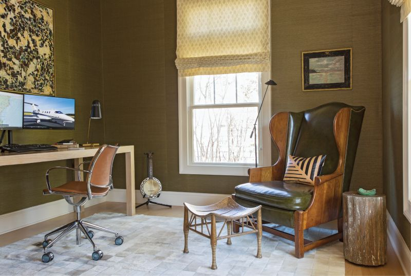 Phil's home office features a custom desk crafted by Josh Brooks of J. Brooks Inc. and a vintage leather wing chair discovered at 17 South Antiques.