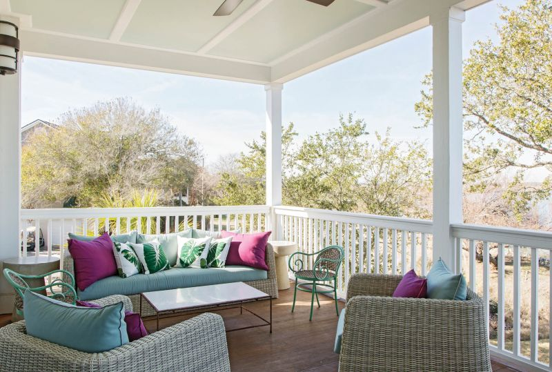 The pillows and cushions for the relaxed outdoor seating areas repeat the deep plum and soft blues from the living room.