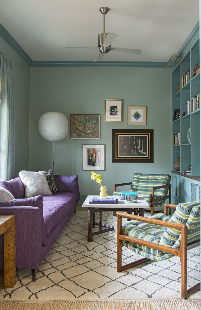 Local artisan Suzanne Allen covered the den walls in a hand-troweled turquoise plaster for a luminous finish. The vintage Moroccan Beni Ourain rug from Imports from Marrakesh and mod cube-scoop chairs from 1stDibs add fun pattern, shape, and texture.