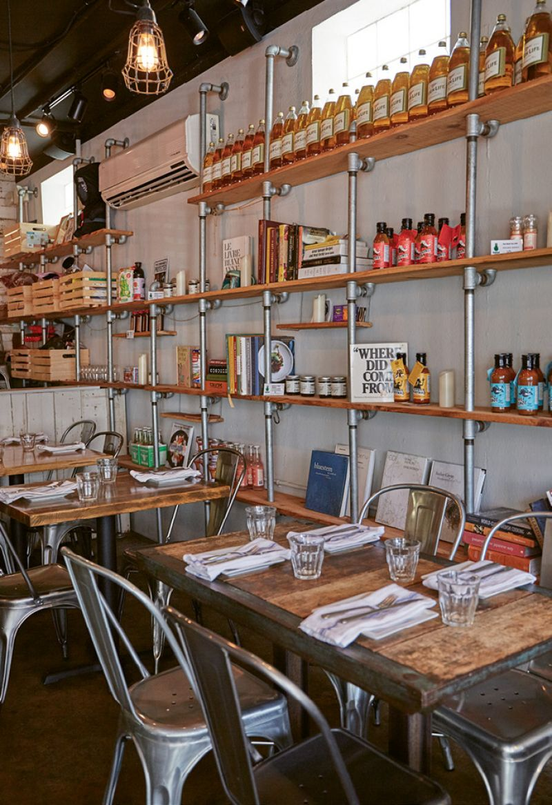 Sorghum & Salt has an urban farmhouse feel, with industrial-style shelves showcasing retail items.