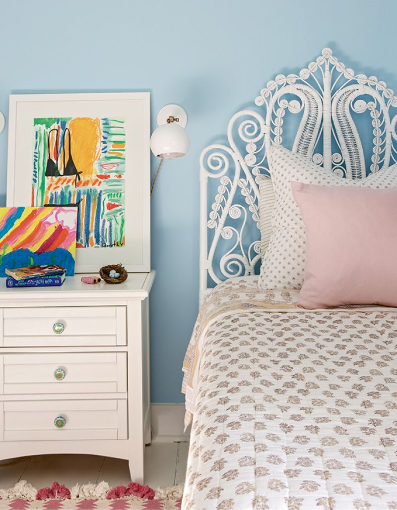 A headboard and rug from Serena and Lily lend a touch of girlish charm to the daughter's bedroom.
