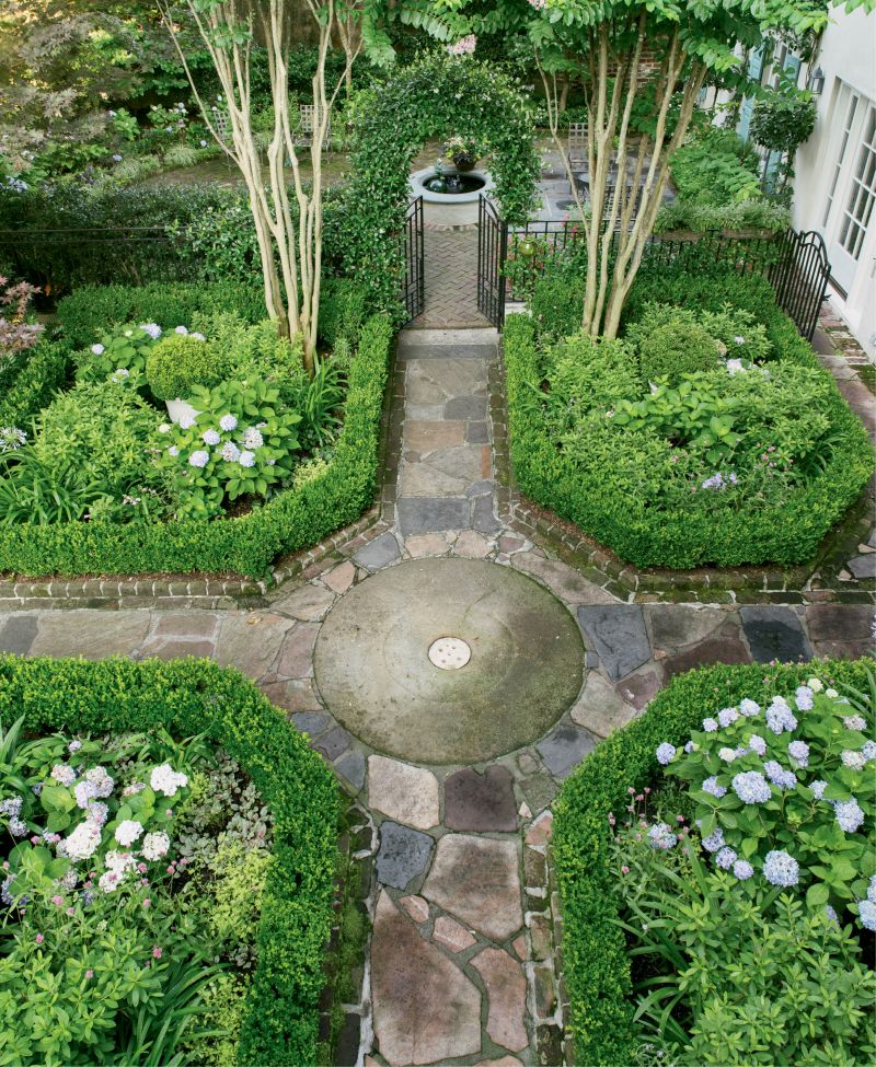 Its green spaces were originally conceived by noted garden designer Loutrel Briggs in 1951 and 1961. While Briggs's initial vision of a French parterre garden and adjacent horseshoe-shaped courtyard remains intact, Monica and landscape architect Sheila Wertimer refreshed the space in 2010, removing overgrown vegetation and swapping in more flowering plants, such as azaleas, agapanthus, and hydrangeas.