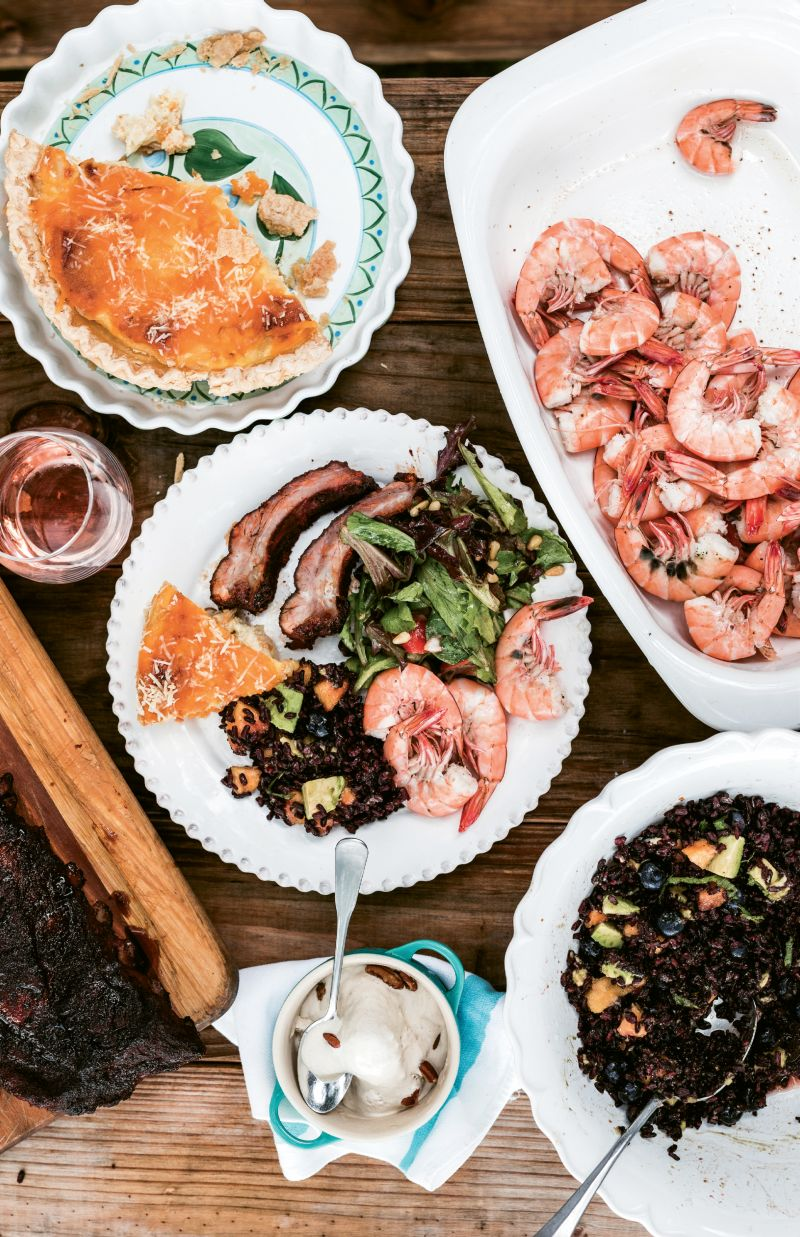 The dinner sides are composed of classic and new flavors: old-school Vidalia onion pie shares the plate with a fresh green salad and black rice tossed with mango.