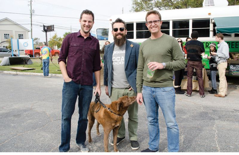 David Tisdale, Larry Downey,  and Kyle McAllister with pooch Putney