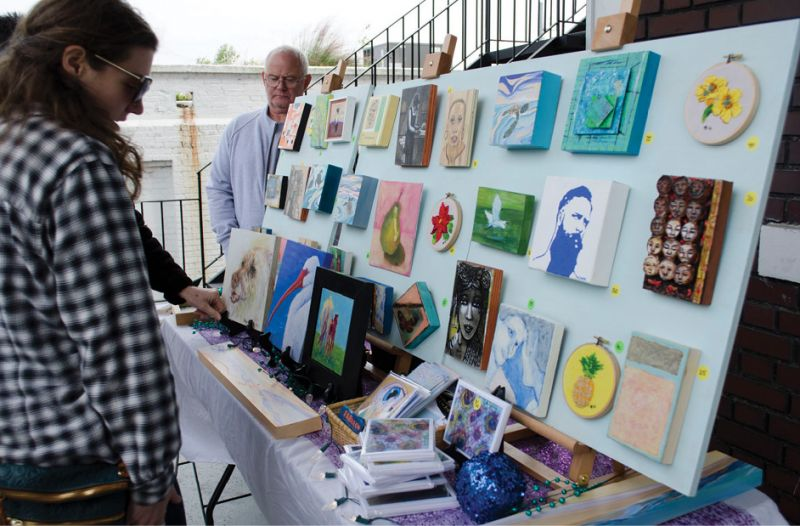 Guests perused a variety of locally made art.