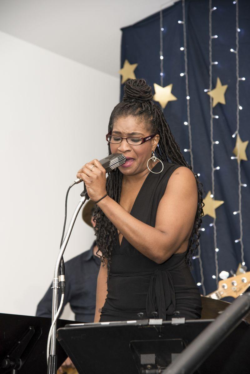 Aisha Kenyatta leads headlining band Sweet Potato.