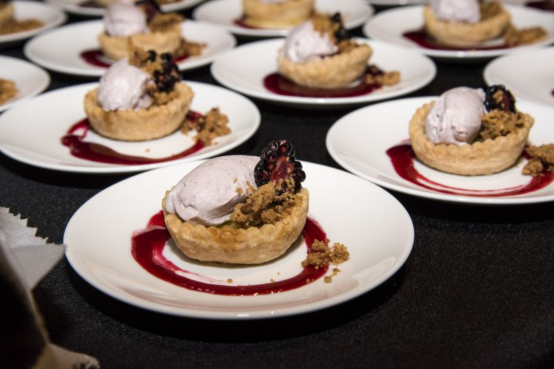 Charleston Grill's buttermilk pie with blackberry bourbon jam, blackberry whipped cream, and brown sugar streusel