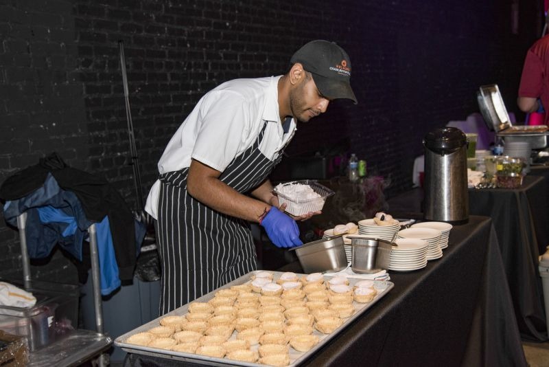 Rouvessen Veerasamy spooned the filling for Charleston Grill's buttermilk pie.