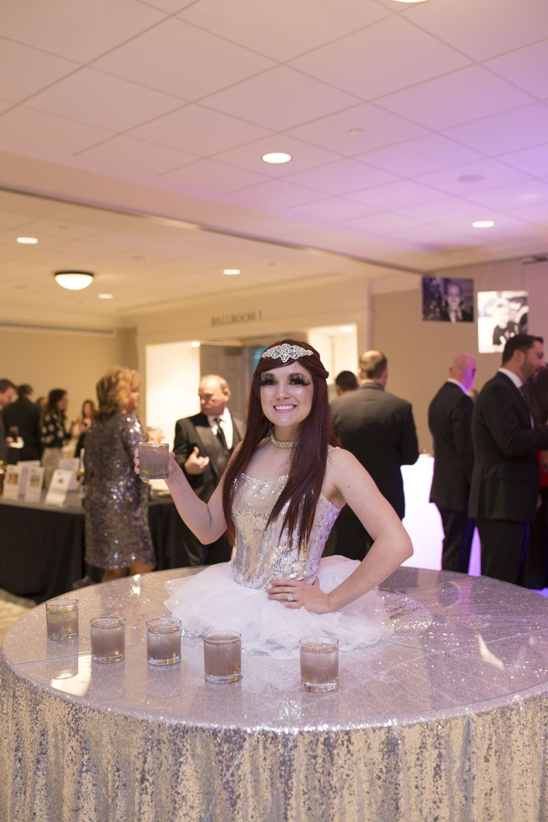 Guests were greeted by an Elevate performer serving drinks.