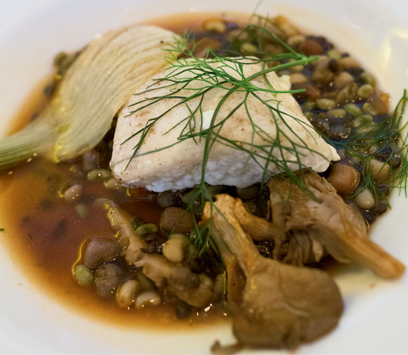 Roasted grouper, local peas and legumes, and caramelized oyster mushrooms with fennel  in a rich umami broth.