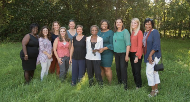 Team Work: Martin-Carrington (center) with her WE BUILD Foundation team—(left to right) Cheryl Wright, Gina Iakovelli, Julie Hussey, Jessica Dye, Gwen Watt, April Magill, Shakeima Chatman, Marie Elana Rowland, Lisa Pansing, and Carmelle Scott—on the site of their first project