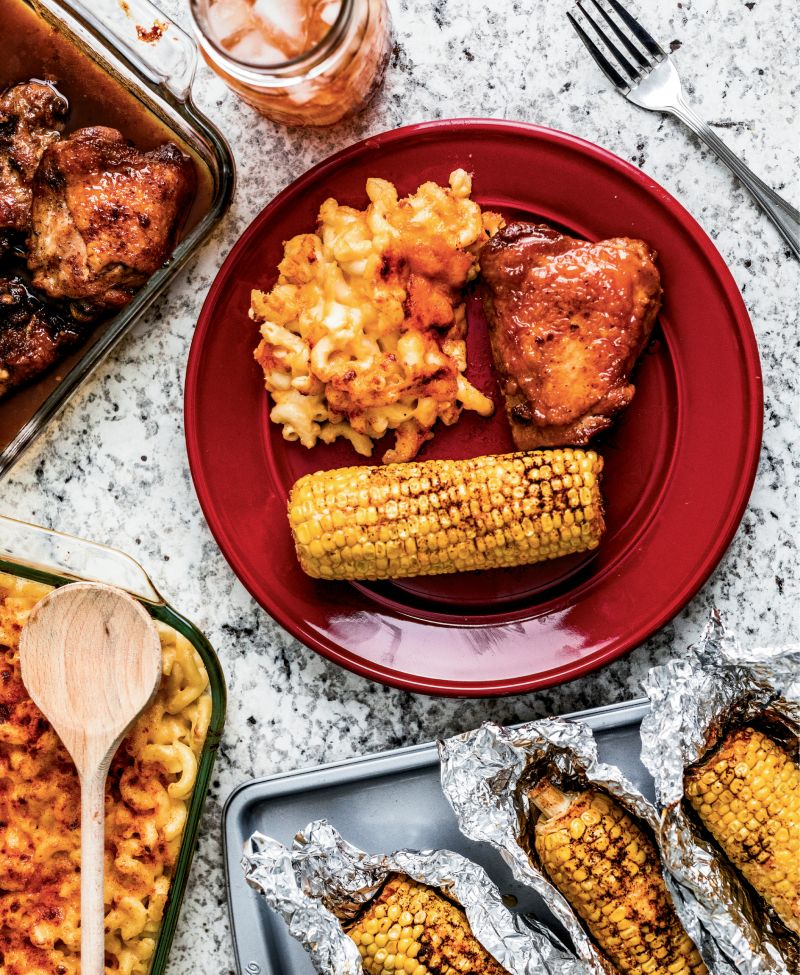 Sweet honey-glazed chicken gets kicked up a notch with sides of paprika-seasoned mac-n-cheese and corn on the cob.